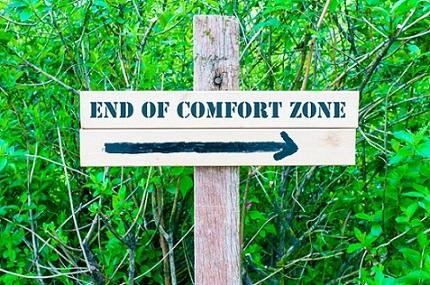 Sign showing the way to the end of the comfort zone