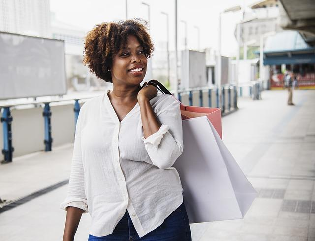 Female customer walking with shopping bag.jpg