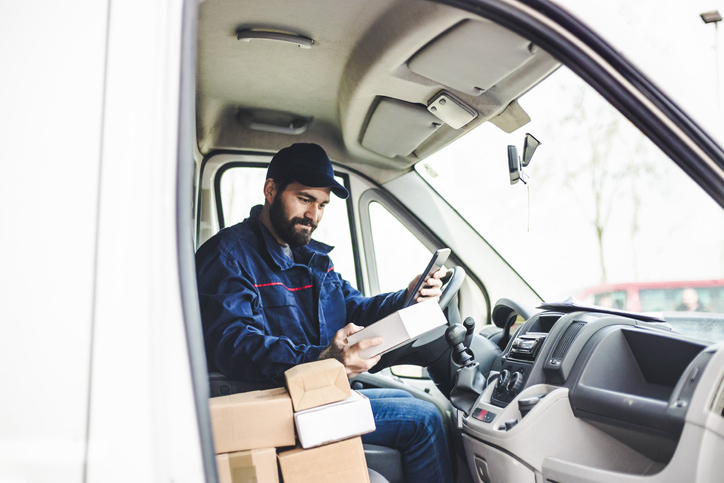 Delivery person with boxes in van.jpg