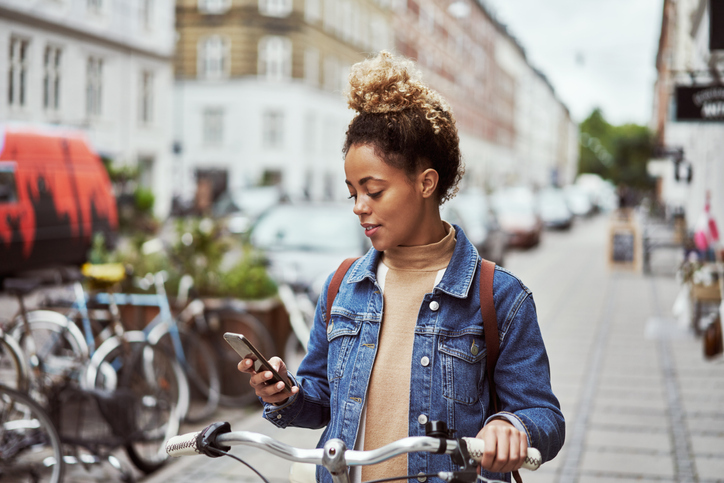 Woman bike location phone.jpg