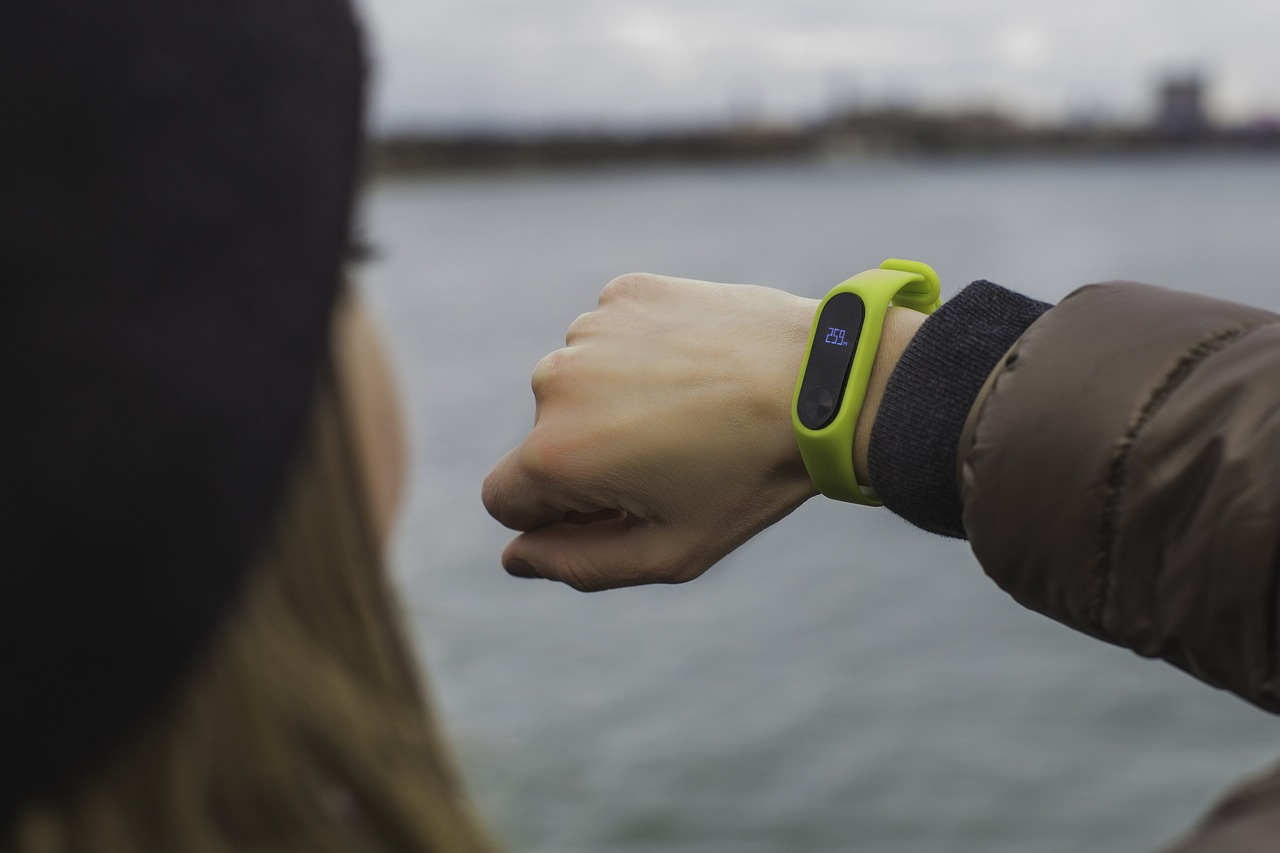 Woman looking at an activity tracker on her wrist