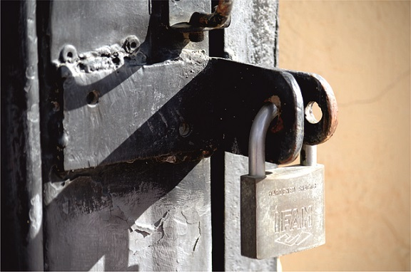 Metal padlock on a metal gate