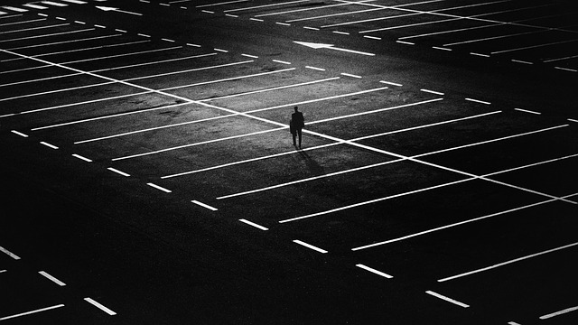 Person in empty parking lot